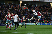 Joe Garner of Preston heads an effort just over from an incoming corner during the Sky Bet Championship match between Preston North End and Burnley at Deepdale, Preston, England on 22 April 2016. Photo by Simon Brady.