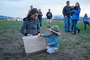 Rachel James of Missoula, Montana, and her young son, attend the candlelight vigil at Fort Missoula for Diren Dede, the German exchange student who was slain by Markus Kaarma on April 27, 2014.