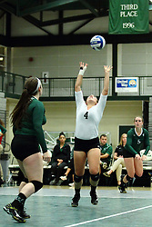 22 September 2015:  Mary Rankin(4) backsets to Tyler Brown(5) during an NCAA womens division 3 Volleyball match between the Augustana Vikings and the Illinois Wesleyan Titans in Shirk Center, Bloomington IL