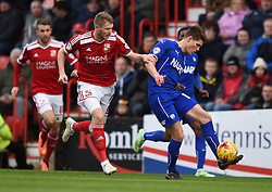 Swindon Town's Michael Smith closes in on Chesterfield's Charlie Raglan in the Sky Bet League One match between Swindon Town and Chesterfield at The County Ground on January 17, 2015 in Swindon, England. - Photo mandatory by-line: Paul Knight/JMP - Mobile: 07966 386802 - 17/01/2015 - SPORT - Football - Swindon - The County Ground - Swindon Town v Chesterfield - Sky Bet League One