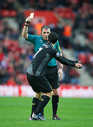 16.03.2013, St. Marys Stadion, Southampton, ENG, Premier League, FC Southampton vs FC Liverpool, 30. Runde, im Bild Referee Phil Dowd shows Liverpool's Luis Alberto Suarez Diaz a yellow card during during the English Premier League 30th round match between Southampton FC and Liverpool FC at the St. Marys Stadium, Southampton, Great Britain on 2013/03/16. EXPA Pictures © 2013, PhotoCredit: EXPA/ Propagandaphoto/ David Rawcliffe..***** ATTENTION - OUT OF ENG, GBR, UK *****