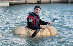 Pumpkin Boat. <br /> Artist Dmitri Galitzine crosses the finish line having set a new Guiness World record for the fastest hundred metres paddled in a Pumpkin boat at Trafalgar Wharf, Port Solent,  Portsmouth, United Kingdom. Wednesday, 23rd October 2013. Picture by Matt Scott-Joynt / i-Images.<br /> UK OUT
