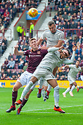 Andy Considine (#4) of Aberdeen FC heads clear from Jimmy Dunne (#3) of Heart of Midlothian during the Ladbrokes Scottish Premiership match between Heart of Midlothian and Aberdeen at Tynecastle Stadium, Edinburgh, Scotland on 20 October 2018.