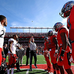 Captains at the coin toss during American Athletic Conference Football action between Rutgers and Cincinnati on Nov. 16, 2013 at High Point Solutions Stadium in Piscataway, New Jersey.