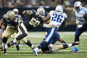 NEW ORLEANS, LA - NOVEMBER 8:  Antonio Andrews #26 of the Tennessee Titans tries to avoid the tackle of Stephone Anthony #26 of the New Orleans Saints at Mercedes-Benz Superdome on November 8, 2015 in New Orleans, Louisiana.  The Titans defeated the Saints in overtime 34-28.  (Photo by Wesley Hitt/Getty Images) *** Local Caption *** Antonio Andrews; Stephone Anthony