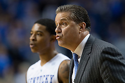 Kentucky head coach John Calipari, right, talks with players during the first half. The University of Kentucky hosted Ole Miss, Saturday, Jan. 02, 2016 at Rupp Arena in Lexington.