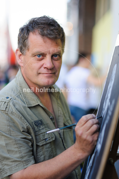 Humber Street SESH, Hull, East Yorkshire. August 3, 2013. Pictured Artist Steve Davis paints Mick Ronson