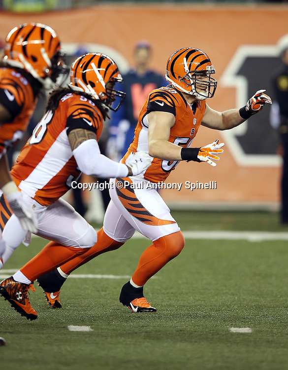 Cincinnati Bengals outside linebacker A.J. Hawk (50) leads defenders who rush the quarterback during the 2015 week 10 regular season NFL football game against the Houston Texans on Monday, Nov. 16, 2015 in Cincinnati. The Texans won the game 10-6. (©Paul Anthony Spinelli)