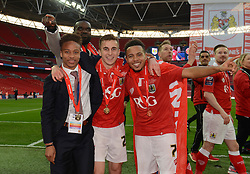 Bristol City's Bobby Reid, Joe Bryan and Korey Smith celebrate the win against Walsall in the Johnstone Paint Trophy - Photo mandatory by-line: Dougie Allward/JMP - Mobile: 07966 386802 - 22/03/2015 - SPORT - Football - London - Wembley Stadium - Bristol City v Walsall - Johnstone Paint Trophy Final