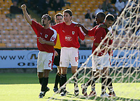 Photo: Paul Thomas.<br /> Port Vale v Bristol City. Coca Cola League 1. 23/09/2006.<br /> <br /> Bristol players Scott Murray (7), Cole Skuse (14) and Jennison Williams (2nd R) celebrate Phil Jevons (R) goal.