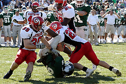 07 October 2006: Marcus Dunlop is upended by Dave Linn (27) and Tom DeBaker (39). The Titans of Illinois Wesleyan University started off strong with a touchdown on the 2nd play from scrimmage in the game.  The Titans led most of the way, but failed to maintain the lead in the 4th quarter giving up the decision of this CCIW conference game to the Red Men of Carthage by a score of 31 - 28. Action was at Wilder Field on the campus of Illinois Wesleyan University in Bloomington Illinois.<br />