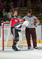 KELOWNA, CANADA - OCTOBER 10:  Jordon Cooke #30 of the Kelowna Rockets discusses the call with referee Brett Iverson as the Spokane Chiefs visit the Kelowna Rockets on October 10, 2012 at Prospera Place in Kelowna, British Columbia, Canada (Photo by Marissa Baecker/Shoot the Breeze) *** Local Caption ***