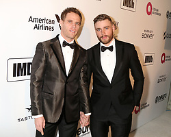 February 24, 2019 - West Hollywood, CA, USA - LOS ANGELES - FEB 24:  Matthew Wilkas, Gus Kenworthy at the Elton John Oscar Viewing Party on the West Hollywood Park on February 24, 2019 in West Hollywood, CA (Credit Image: © Kay Blake/ZUMA Wire)