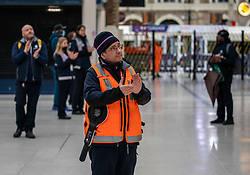 © Licensed to London News Pictures. 28/04/2020. London, UK. Staff at Victoria Station in Westminster clap for fallen key workers after the 1 minute silence. UK holds a minute silence for key workers who have died in the coronavirus pandemic as the Office for National Statistics reveals there were 1000s of more deaths due to Covid-19 outside of hospitals as the coronavirus pandemic crisis continues. Photo credit: Alex Lentati/LNP