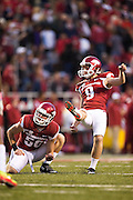 FAYETTEVILLE, AR - OCTOBER 31:  Cole Hedlund #9 of the Arkansas Razorbacks kicks a extra point during a game against the UT Martin Skyhawks at Razorback Stadium on October 31, 2015 in Fayetteville, Arkansas.  The Razorbacks defeated the Skyhawks 63-28.  (Photo by Wesley Hitt/Getty Images) *** Local Caption *** Cole Hedlund