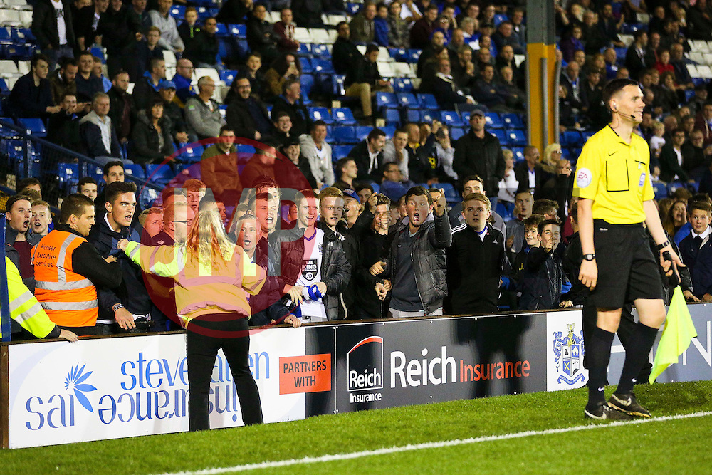 Bury fans confront the linesman for not giving offside for Leicester City's fourth goal - Mandatory byline: Matt McNulty/JMP - 07966386802 - 25/08/2015 - FOOTBALL - Gigg Lane -Bury,England - Bury v Leicester City - Capital One Cup - Second Round