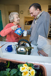IndependentAge volunteer and older woman making a cup of tea together,