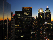 Sunset over high-rise buildings in Midtown Manhattan in New York, NY. Nice reflection in the windows of a skyscraper!