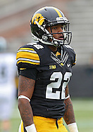 October 6 2013: Iowa Hawkeyes wide receiver Damond Powell (22) warms up with the team before the start of the NCAA football game between the Michigan State Spartans and the Iowa Hawkeyes at Kinnick Stadium in Iowa City, Iowa on October 6, 2013. Michigan State defeated Iowa 26-14.