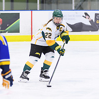 5th year defender Alexis Larson (22) of the Regina Cougars in action during the Women's Hockey Home Game on October 14 at Co-operators arena. Credit: Arthur Ward/Arthur Images