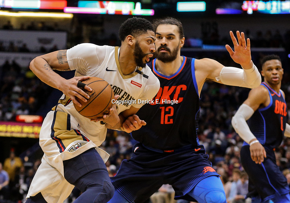 Apr 1, 2018; New Orleans, LA, USA; New Orleans Pelicans forward Anthony Davis (23) drives past Oklahoma City Thunder center Steven Adams (12) during the second half at the Smoothie King Center. The Thunder defeated the Pelicans 109-104. Mandatory Credit: Derick E. Hingle-USA TODAY Sports