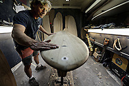 Jon Wegener works on a wooden surfboard at his shop in Encinitas, CA on Thursday, November 14, 2013.  Wegener and his Brother constuct surfboards inspired by ancient Polynisian technology by using lightweight wood with a hollow core.(Photo by Sandy Huffaker for The New York Times)