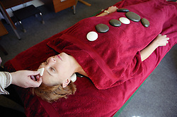 Patient having La Stone Therapy,