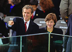 Businessman George W. Bush waves from the podium prior to his Dad, United States President-elect George H.W. Bush being sworn-in as 41st President of the United States at the US Capitol on January 20, 1989. At right is his wife, Laura Bush. Photo by Arnie Sachs / CNP /ABACAPRESS.COM