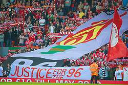 LIVERPOOL, ENGLAND - Sunday, April 11, 2010: Liverpool's supporters on the Spion Kop display banners to mark the 21st anniversary of the Hillsborough Stadium Disaster of the 15th April 1989, in which 96 Liverpool supporters lost their lives, before the Premiership match against Fulham at Anfield, the nearest game to the anniversary. (Photo by: David Rawcliffe/Propaganda)