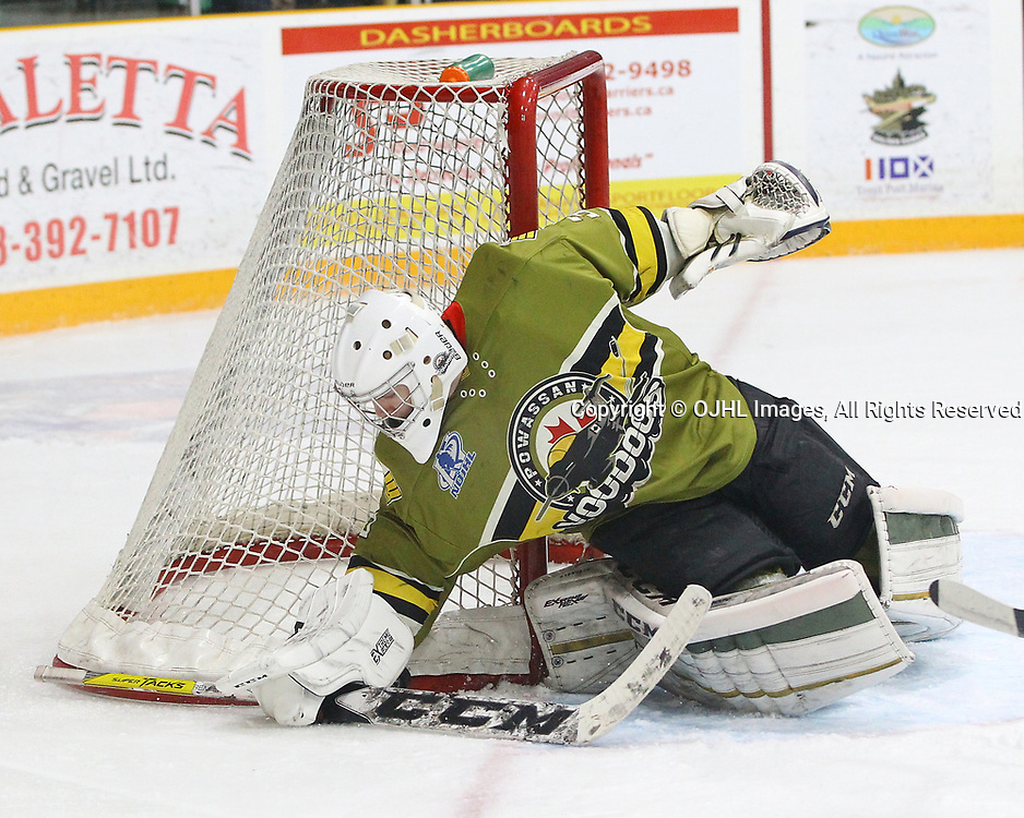 TRENTON, ON  - MAY 4,  2017: Canadian Junior Hockey League, Central Canadian Jr. &quot;A&quot; Championship. The Dudley Hewitt Cup. Game 5 between Powassan Voodoos and the Georgetown Raiders.  Nate McDonald #33 of the Powassan Voodoos covers the puck during the first period.<br /> (Photo by Tim Bates / OJHL Images)