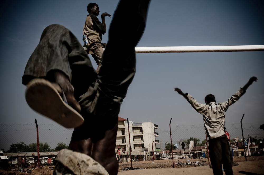 Children play prior to a voter's education seminar in Southern Sudan's capital city Juba. Southern Sudan will vote on January 9 to decide whether or not to remain as part of Sudan or set off alone as the world's newest country. (© William B. Plowman)