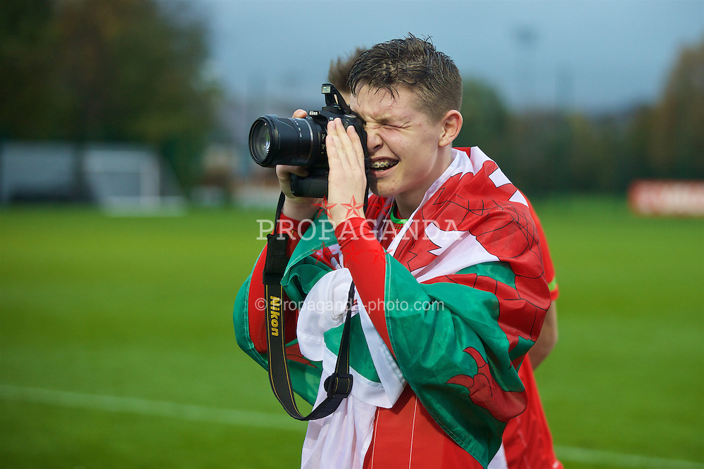 NEWPORT, WALES - Thursday, November 5, 2015: Wales' Kieron Holsgrove takes a photo after the 3-1 victory over Northern Ireland helped Wales retain the trophy during the Under-16's Victory Shield International match at Dragon Park. (Pic by David Rawcliffe/Propaganda)