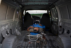 A dead man is taken awar from a crime scene.  He was found dead in a canal after having been shot multiple times in the face during what is believed to be an execution by a drug cartel.