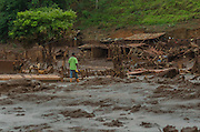 A man walks over the mud in order to feed pets that remains in Paracatu de Baixo, one of the districts of Mariana, a brazilian city in the state of Minas Gerais. On november 5th, a mining waste dam failed causing a flood of mud.