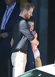 AU_1373725 - Sydney, AUSTRALIA  -   Prince Harry gives Jordan  Ilencik 13 of Campbelltown a hug following his BridgeClimb.<br />