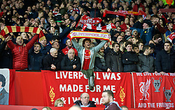 MANCHESTER, ENGLAND - Wednesday, March 16, 2016: Liverpool supporters celebrate their 3-1 aggregate victory over Manchester United during the UEFA Europa League Round of 16 2nd Leg match at Old Trafford. (Pic by David Rawcliffe/Propaganda)