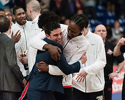 © Licensed to London News Pictures. 28/04/2013. London, UK.  Coach Rob Paternostro of The Leicester Riders celebrates with one of players as his team beats the Newcastle Eagles in the playoff final of the British Basketball League 2013 - the Newcastle Eagles are defending their title having won it in 2012.  The British Basketball League (BBL), is the premier men's professional basketball league in the United Kingdom. The BBL runs two knockout competitions alongside the league Championship; the BBL Cup and the BBL Trophy, as well as the post-season Play-offs.  Photo credit : Richard Isaac/LNP