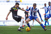 Ollie Rathbone and Jay Fulton during the EFL Sky Bet League 1 match between Wigan Athletic and Rochdale at the DW Stadium, Wigan, England on 24 February 2018. Picture by Daniel Youngs.