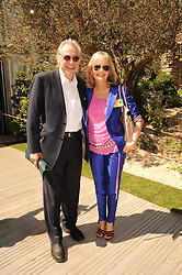 Th 2010 Royal Horticultural Society Chelsea Flower show in the grounds of Royal Hospital Chelsea, London on 24th May 2010.<br /> <br /> Picture shows:-TWIGGY and her husband LEIGH LAWSON