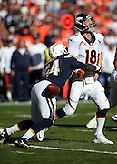 Denver Broncos quarterback Peyton Manning (18) fumbles the ball as he gets sacked for a loss of 7 yards in the first quarter by San Diego Chargers outside linebacker Melvin Ingram (54) during the NFL week 15 regular season football game against the San Diego Chargers on Sunday, Dec. 14, 2014 in San Diego. The Broncos won the game 22-10. ©Paul Anthony Spinelli