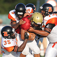 Ashley's Jalen Mack is tackled by Wallace-Rose Hill's Rarkell Simmons, bottom-left, Tony Frierson, center, and Douglas Rodriguez in the first game of the 28th Annual BB&T Football Jamboree Friday August 15, 2014 at Legion Stadium in Wilmington, N.C. (Jason A. Frizzelle)