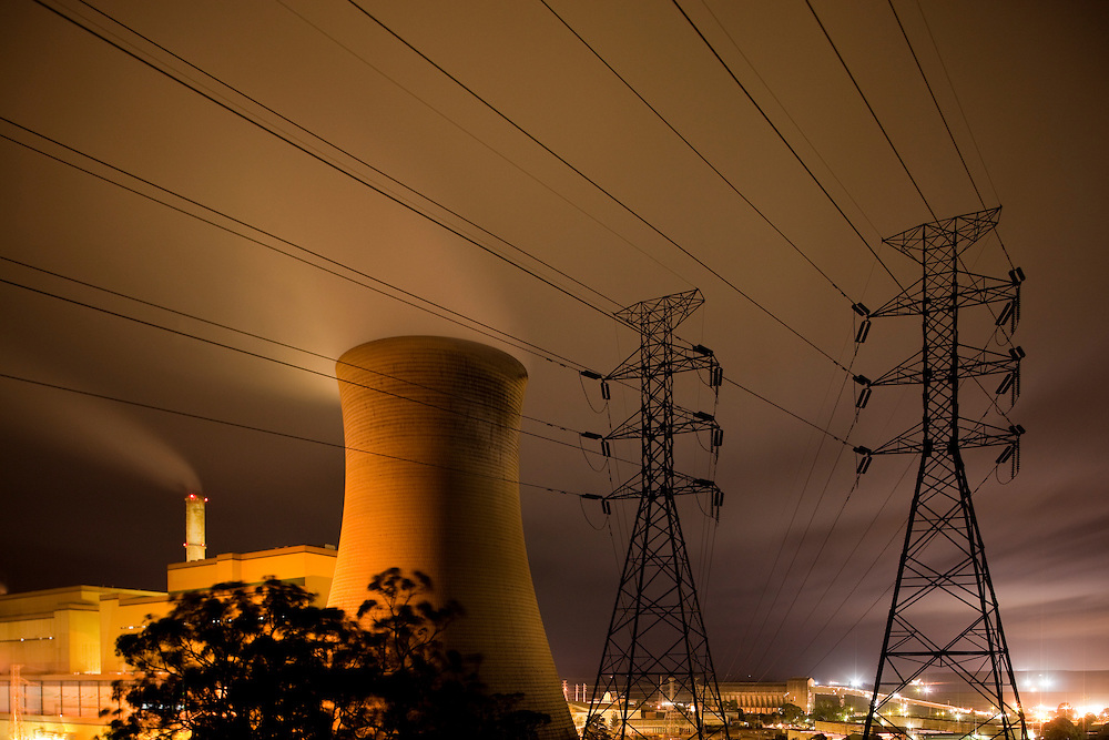 Australia, Victoria, Yallourn, Time exposure of Tru Energy coal-fired power station and high tension lines at night
