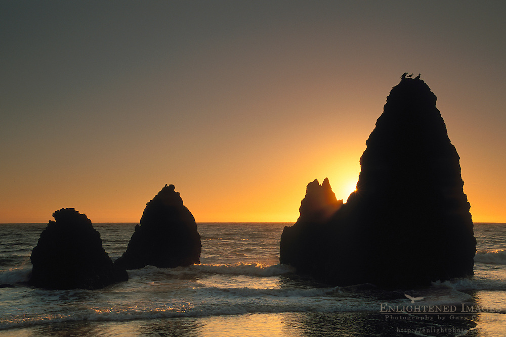 Sunset and waves against coastal rock seastack at Rodeo Beach, Marin Headlands, California