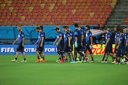 The Italy team walk out onto the pitch during the Italy open training session at Arena da Amazonia, Manaus, Brazil<br /> Picture by Andrew Tobin/Focus Images Ltd +44 7710 761829<br /> 13/06/2014