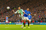 Christopher Jullien of Celtic FC holds off Alfredo Morelos of Rangers FC during the Betfred Scottish League Cup Final match between Rangers and Celtic at Hampden Park, Glasgow, United Kingdom on 8 December 2019.