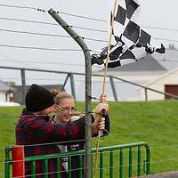 Ennistymon Supporters raise their flag during the U14 Football Final in Quilty