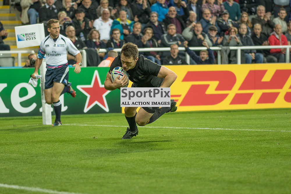 New Zealand #15 Ben Smith dives over for New Zealand's first try.<br /> New Zealand v Tonga, 9th October 2015