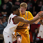 31 January 2017:  The San Diego State Aztecs men's basketball team hosts Wyoming Tuesday night at Viejas Arena. San Diego State guard Dakarai Allen (4) attempts to steal the ball from Wyoming forward Hayden Dalton (20) in the second half. The Aztecs beat the Cowboys 77-68 at half time. www.sdsuaztecphotos.com