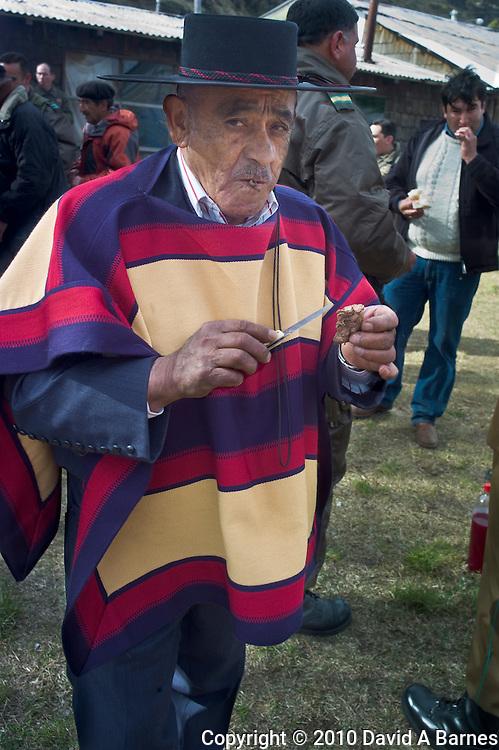 Gaucho at asado, Villa Cerro Castillo, Aysen, Chile
