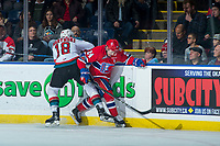 KELOWNA, CANADA - JANUARY 10: Carsen Twarynski #18 of the Kelowna Rockets checks Ty Smith #24 of the Spokane Chiefs at the boards during first period on January 10, 2017 at Prospera Place in Kelowna, British Columbia, Canada.  (Photo by Marissa Baecker/Shoot the Breeze)  *** Local Caption ***